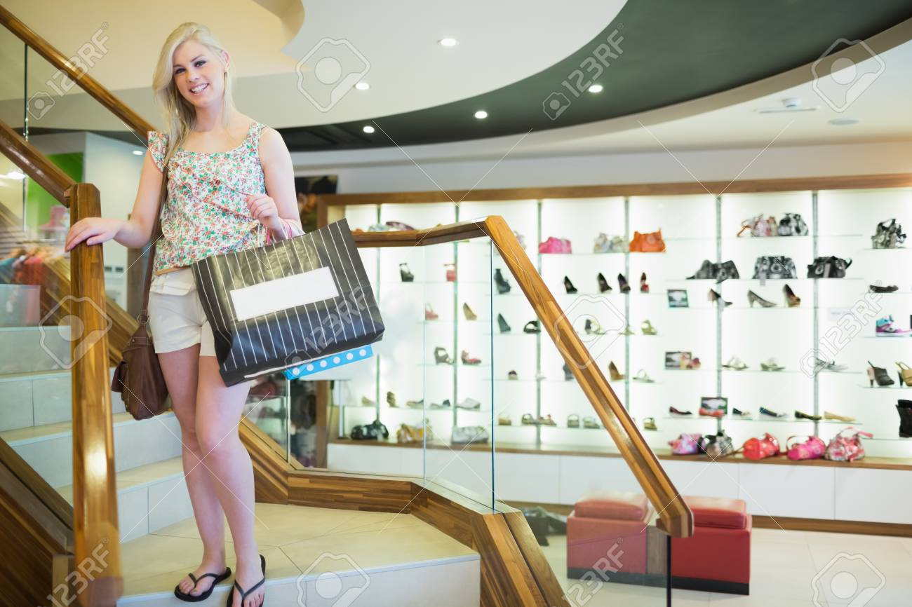 Woman standing at the stairs of a shopping mall Stock Photo - 15593331