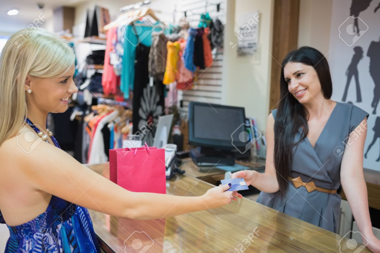 Woman paying with credit card at clothing store Stock Photo - 15593298