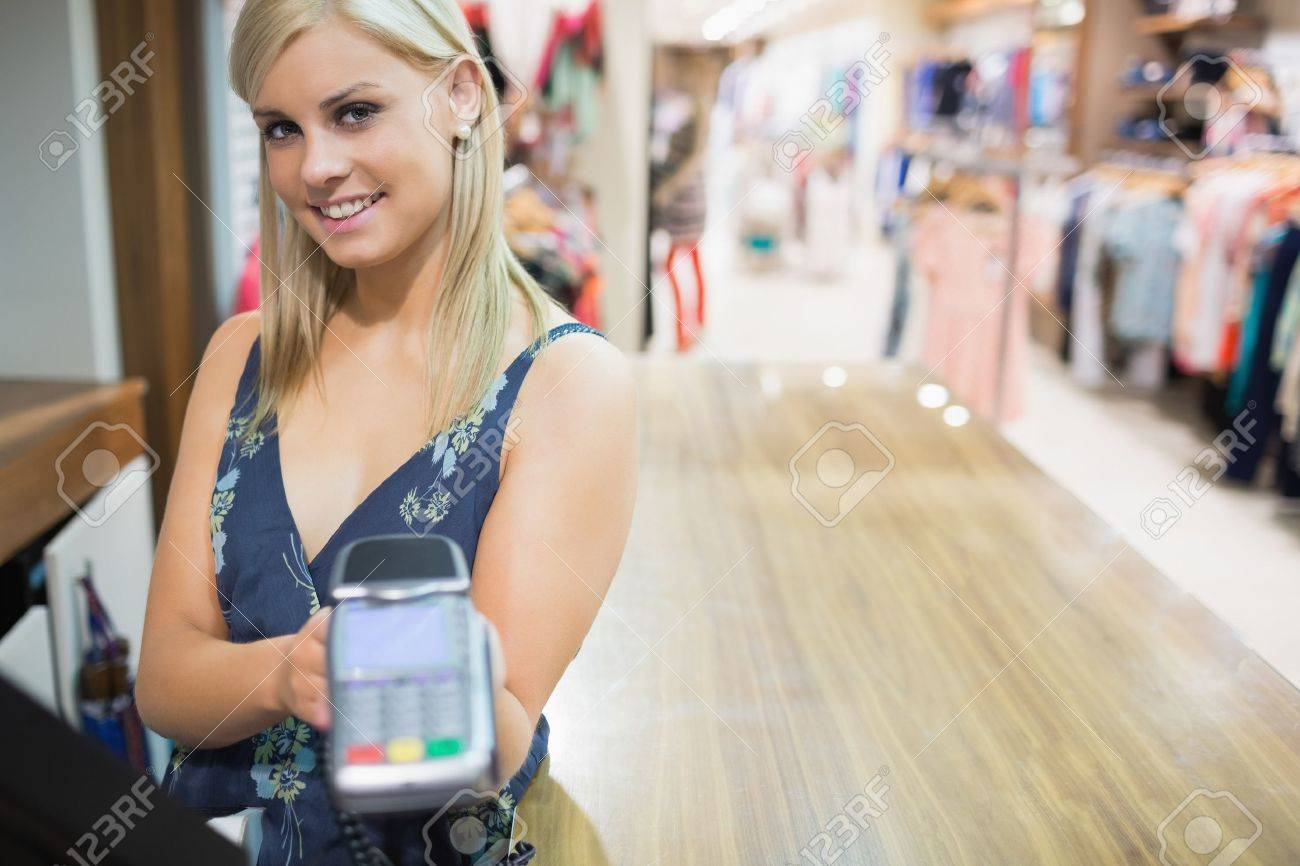 Woman with credit card machine in clothing store Stock Photo - 15592706