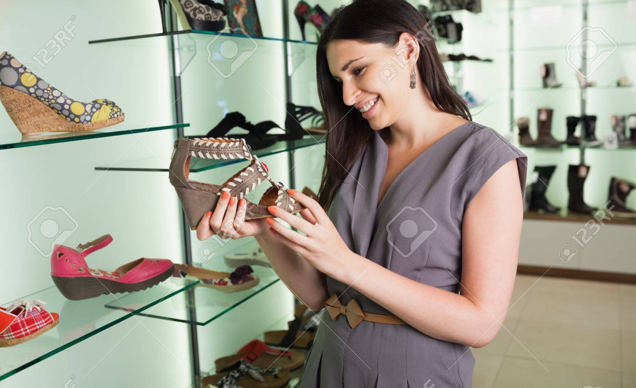 Woman standing in a boutique looking at shoes Stock Photo - 15591976