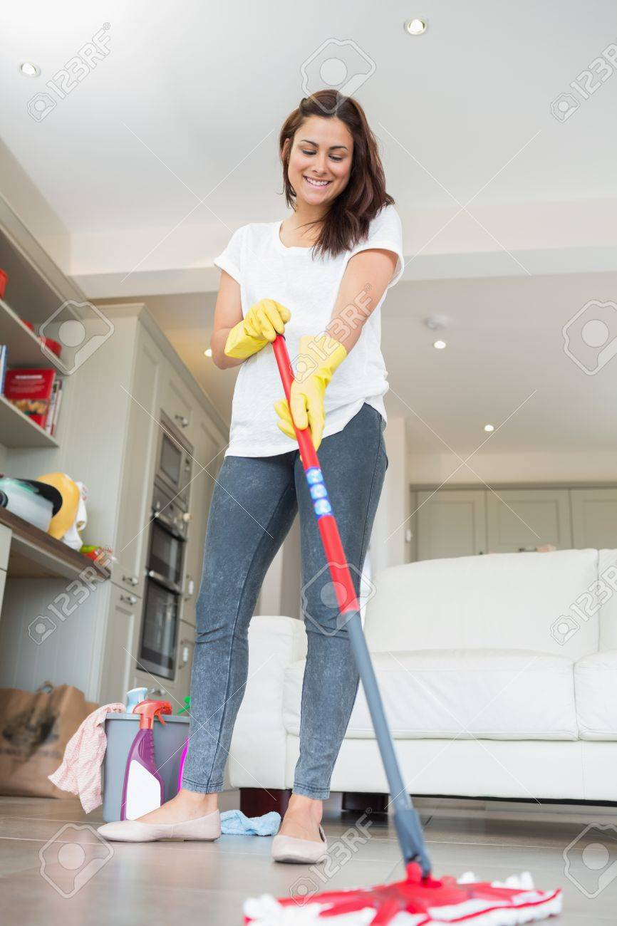 Mopping Kitchen Floor Woman Mopping The Floor Of Living Room Stock Photo Picture And
