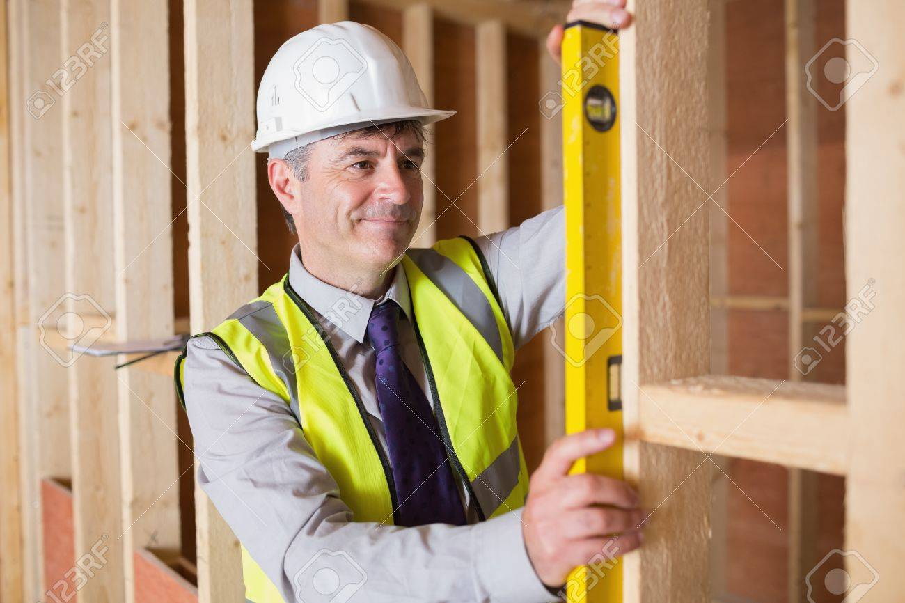 Architect measuring the wood frame with a spirit level Stock Photo - 15584929