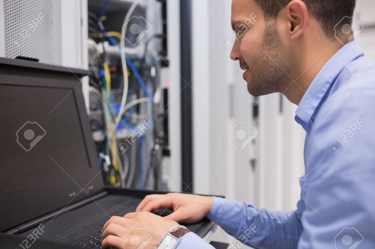 Man repairing servers in data center Stock Photo - 15592960