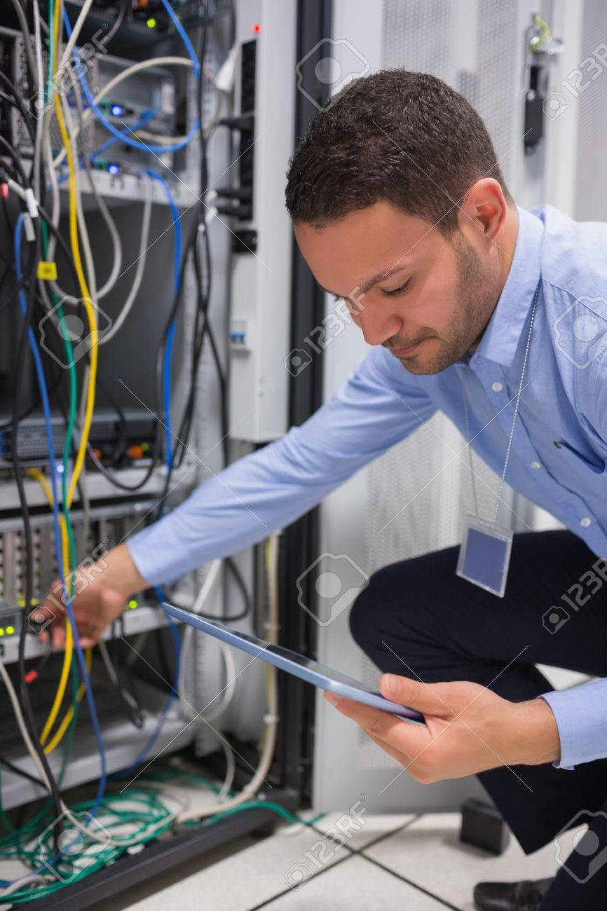 Man using tablet pc to work on servers in data center Stock Photo - 15584923