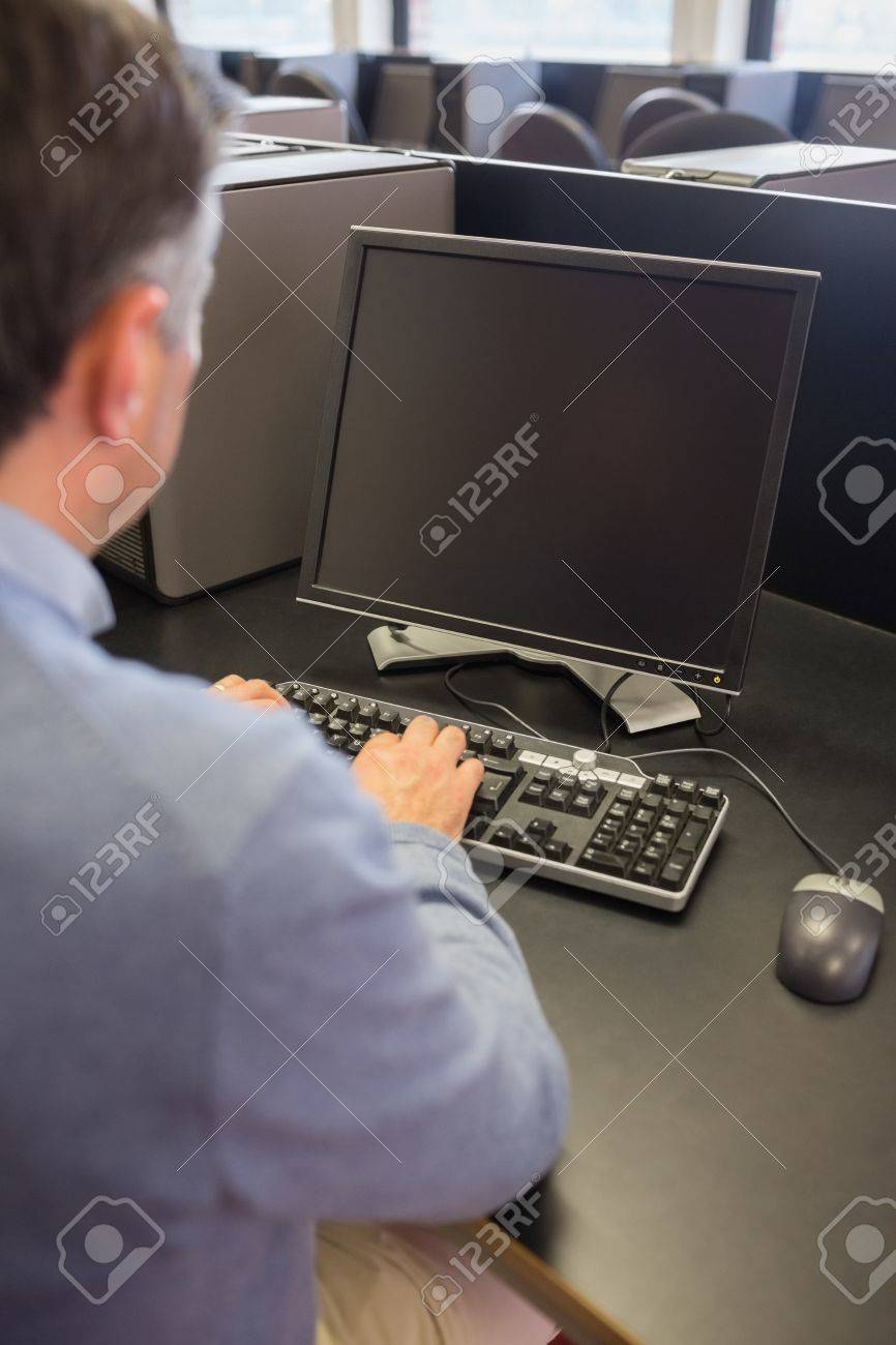 Man working with computer while sitting in class Stock Photo - 15584294