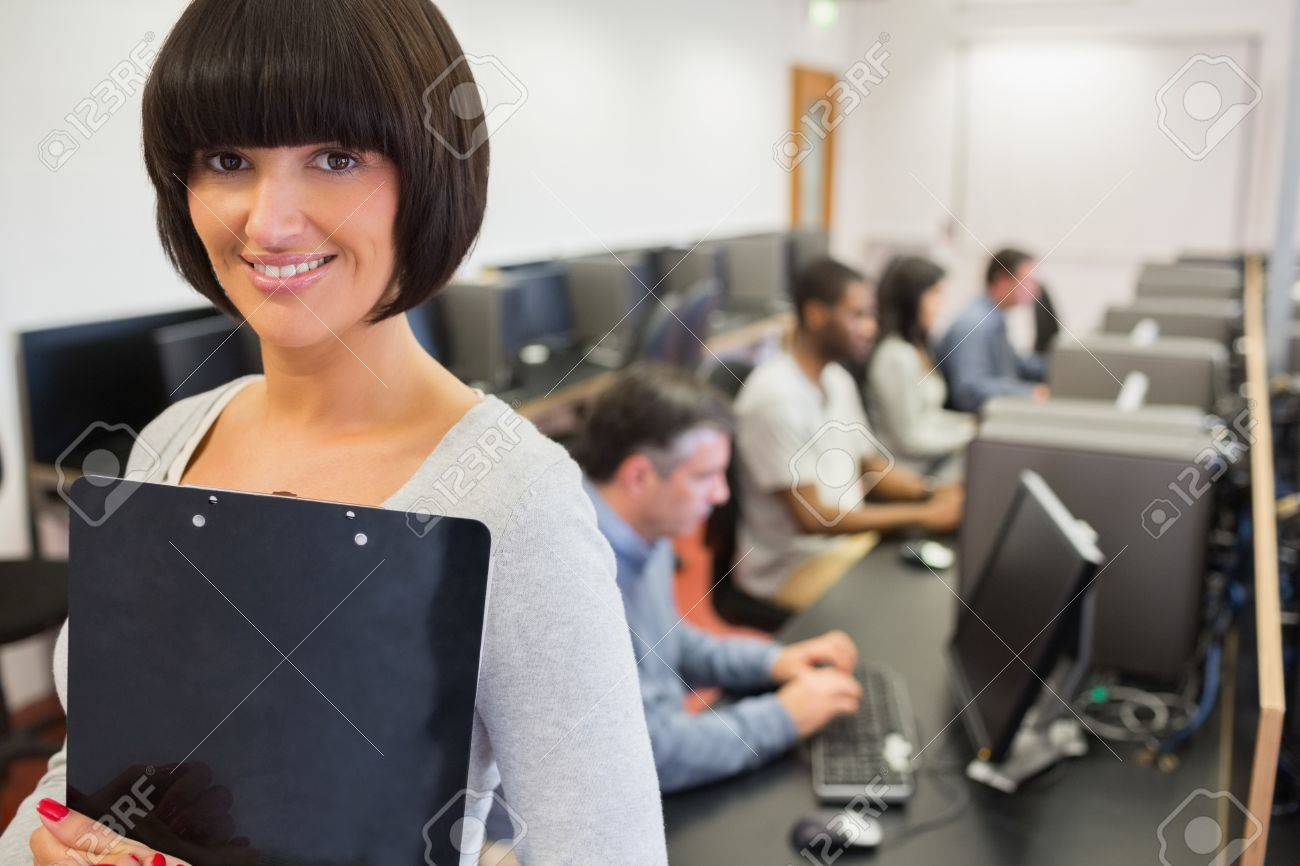 Teacher Smiling In Computer Class College Stock Photo Picture