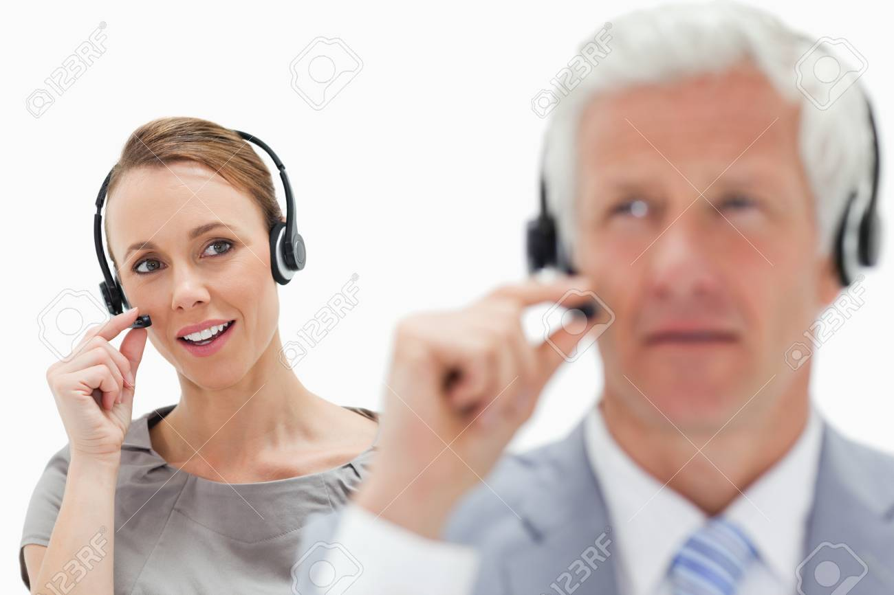 Woman in background man in front wearing a headset against white background Stock Photo - 18679176