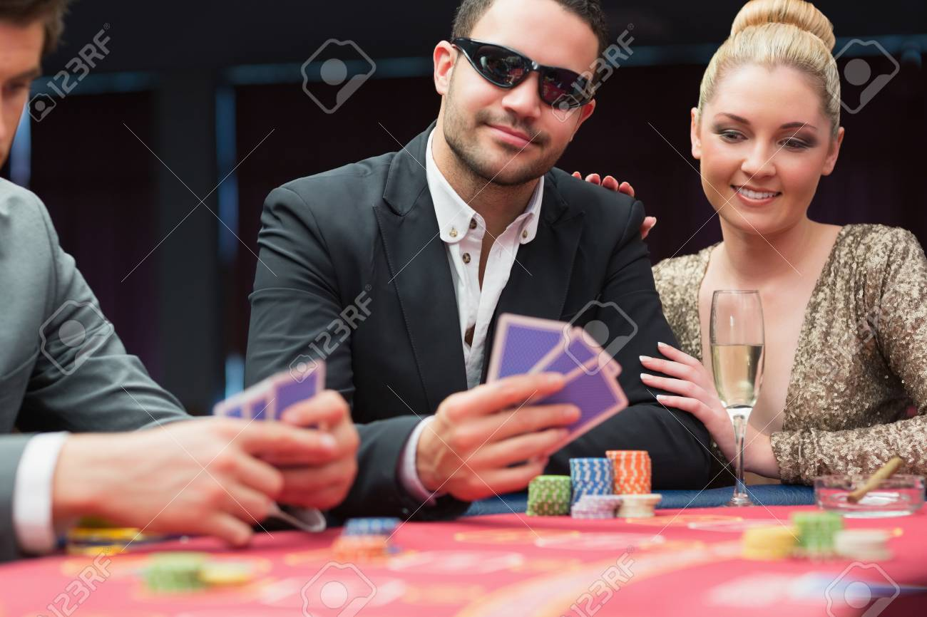 Couple at the poker table in casino Stock Photo - 16076521