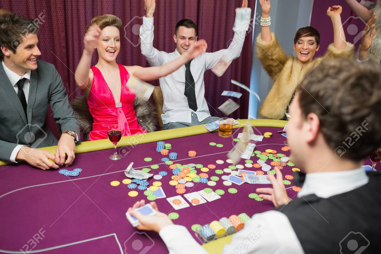 People sitting celebrating at poker game in casino Stock Photo - 16076523