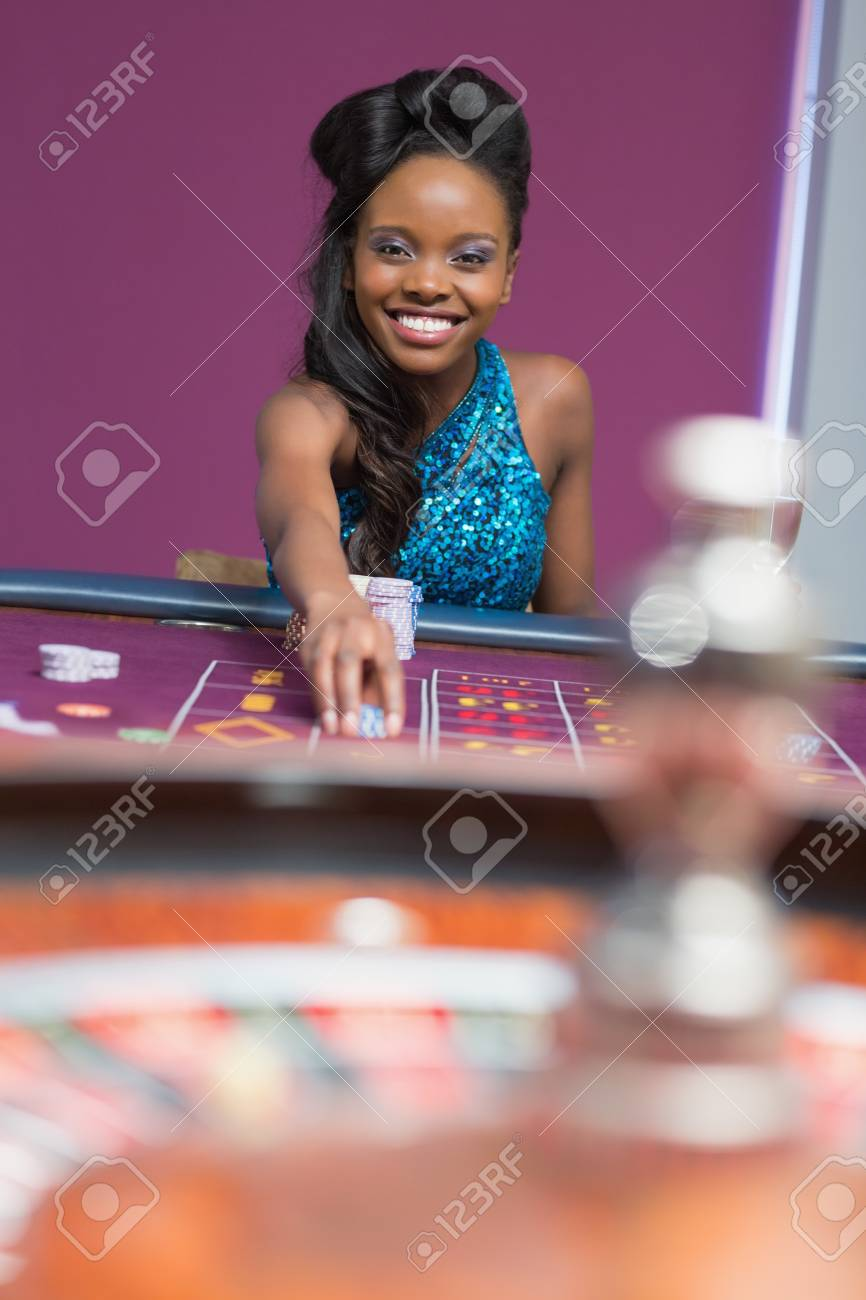 Woman playing roulette at a casino Stock Photo - 16076835