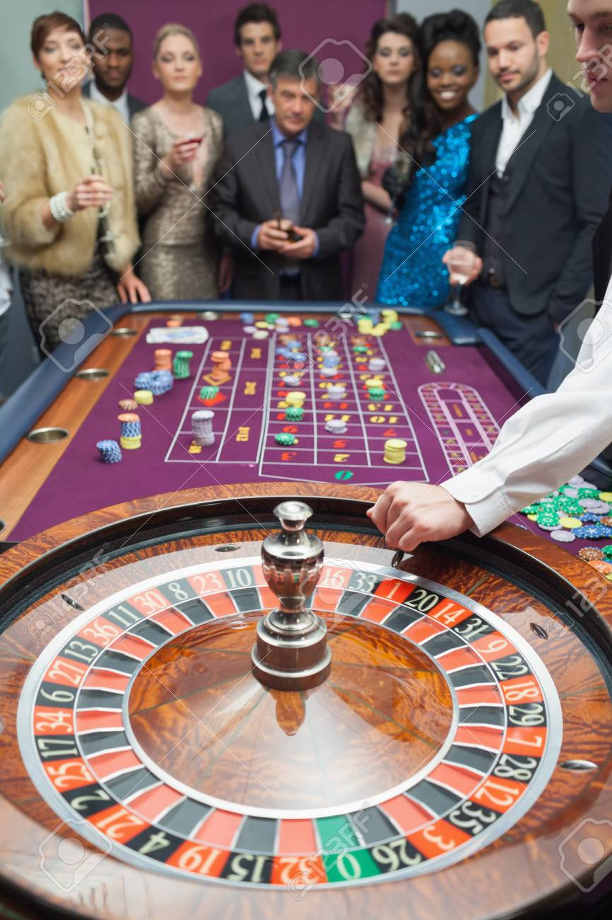 People standing at the roulette table in casino Stock Photo - 16078896