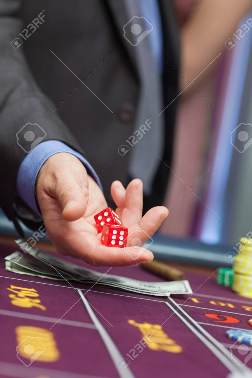 Man holding dice in his hands Stock Photo - 16078526