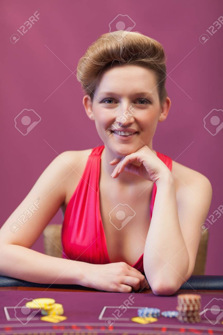 Woman sitting at poker table and smiling Stock Photo - 16065779