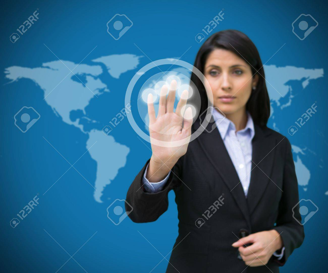 Businesswoman standing touching holographic screen against blue world map background Stock Photo - 16051420