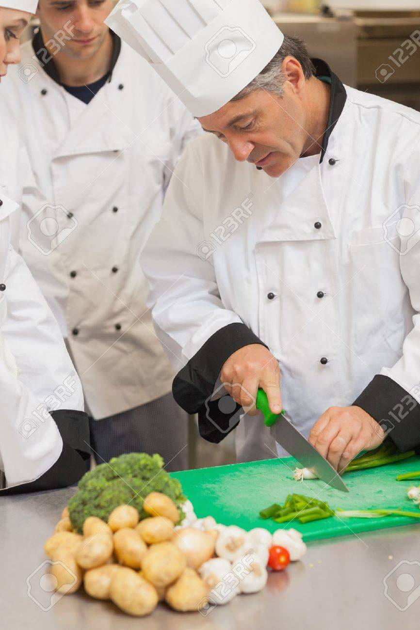 Chef Teaching Group How To Slice Vegetables In The Kitchen Stock ...