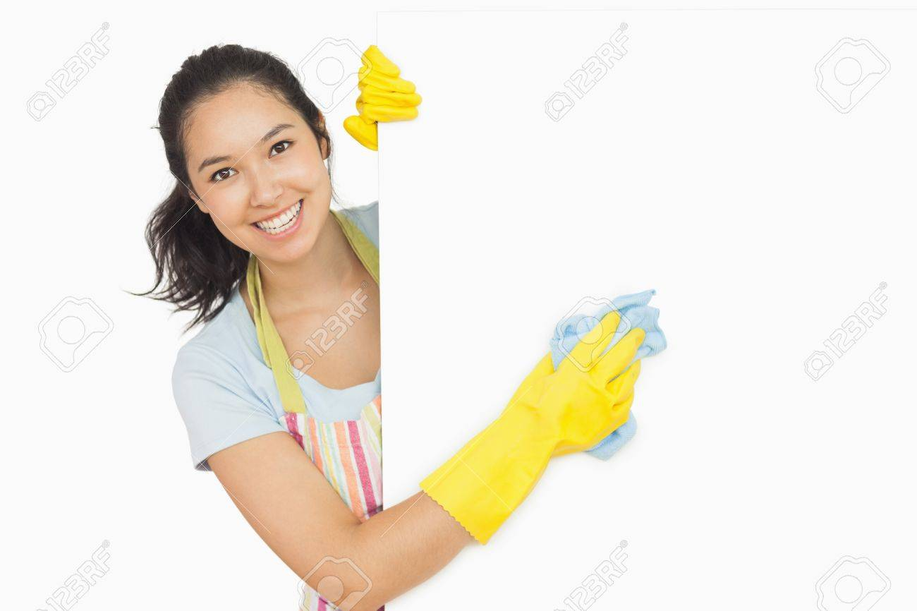 White rubber apron - Cheerful Woman Cleaning White Surface In Apron And Rubber Gloves Stock Photo 16067124