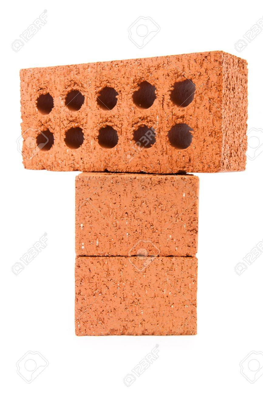 Three clay bricks with holes being stacked against a white background Stock Photo - 16068661