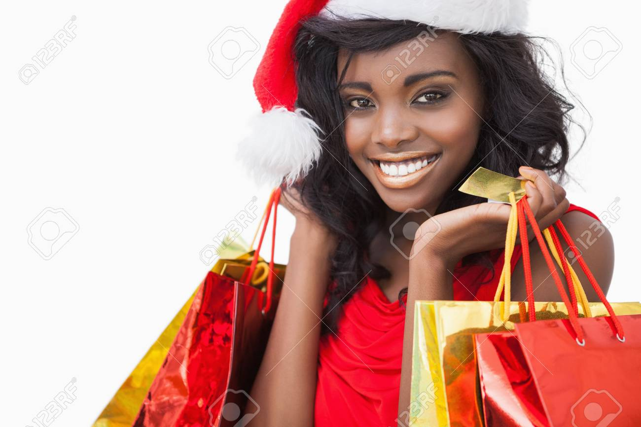 Festive woman standing looking while holding bags and smiling Stock Photo - 16075985