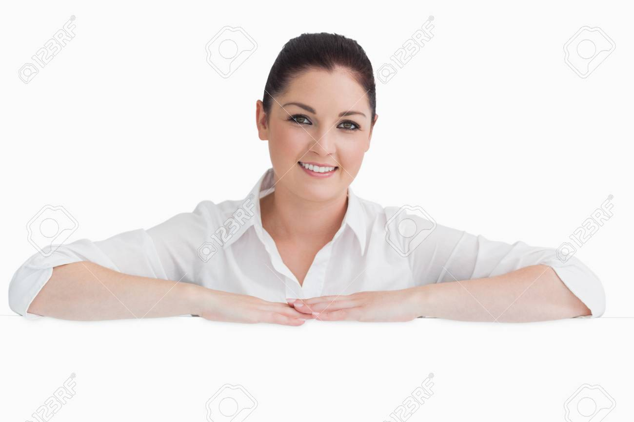 Smiling woman resting on her arms on white background Stock Photo - 16069005