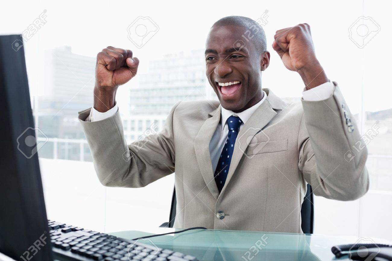 Successful businessman working with a computer in his office Stock Photo - 16076265