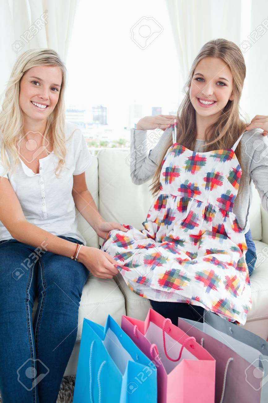 A smiling girl and her friend as they look at the camera while trying out their new clothes Stock Photo - 16238134