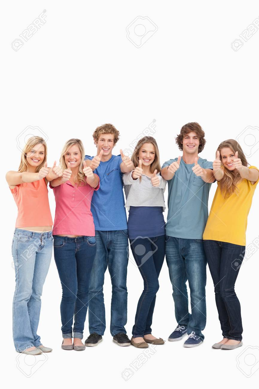 A smiling group of friends giving at thumbs up while looking at the camera Stock Photo - 16235009