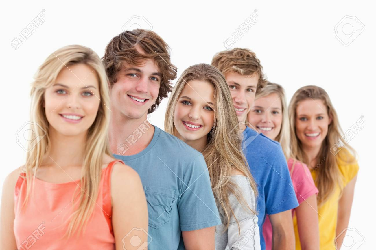 A smiling group standing behind each other at an angle while looking into the camera Stock Photo - 16237467