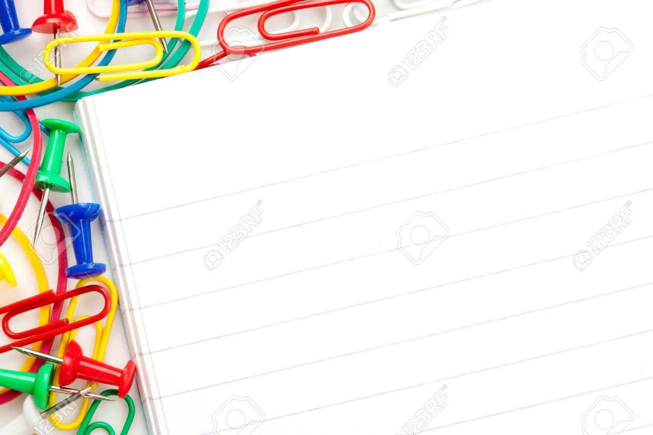 notepad with large group of muti coloured stationery against stock