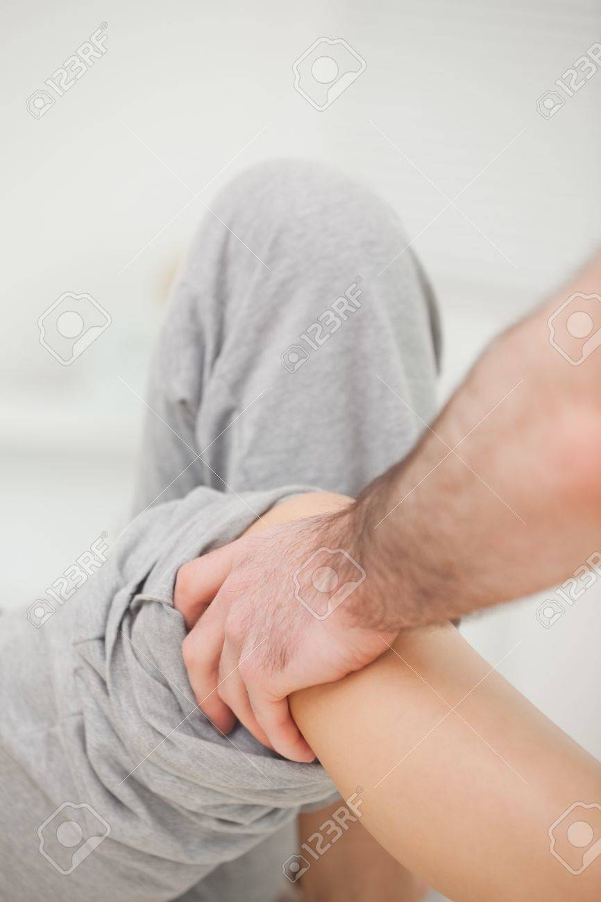 Practitioner looking at the leg of his patient in a room Stock Photo - 16204709