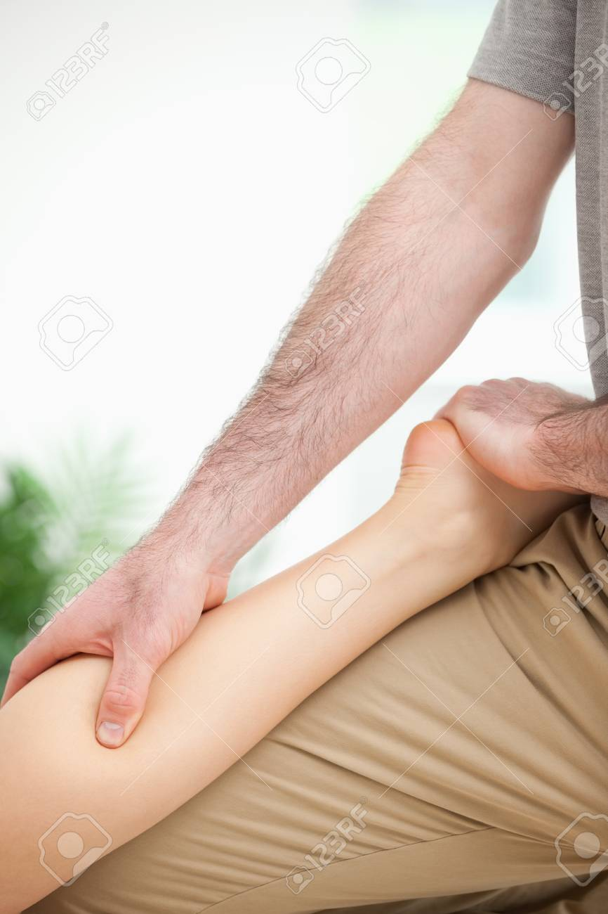 Physiotherapist massaging the leg of a woman in a room Stock Photo - 16207340