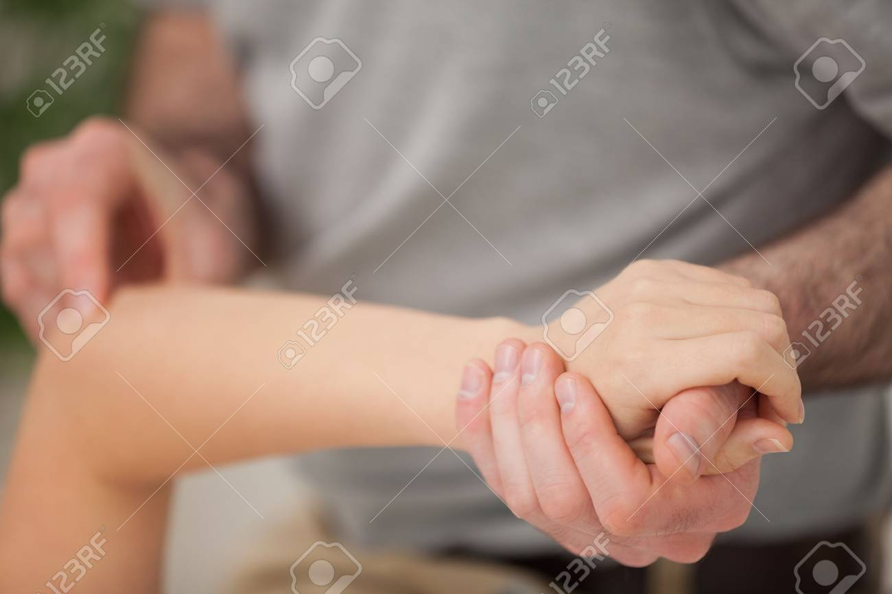 Arm of a woman being manipulated in a room Stock Photo - 16207557