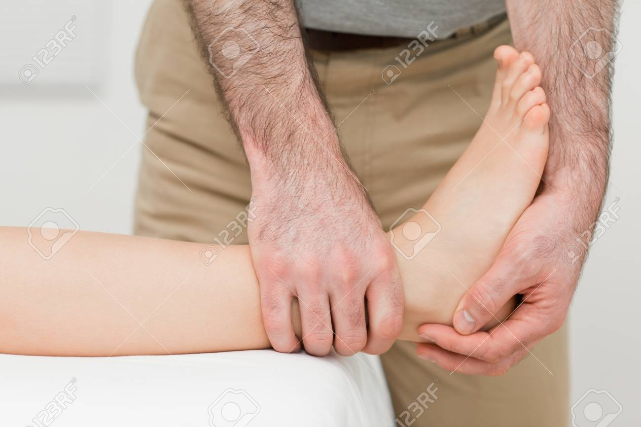 Ankle of a patient being manipulated in a room Stock Photo - 16207453