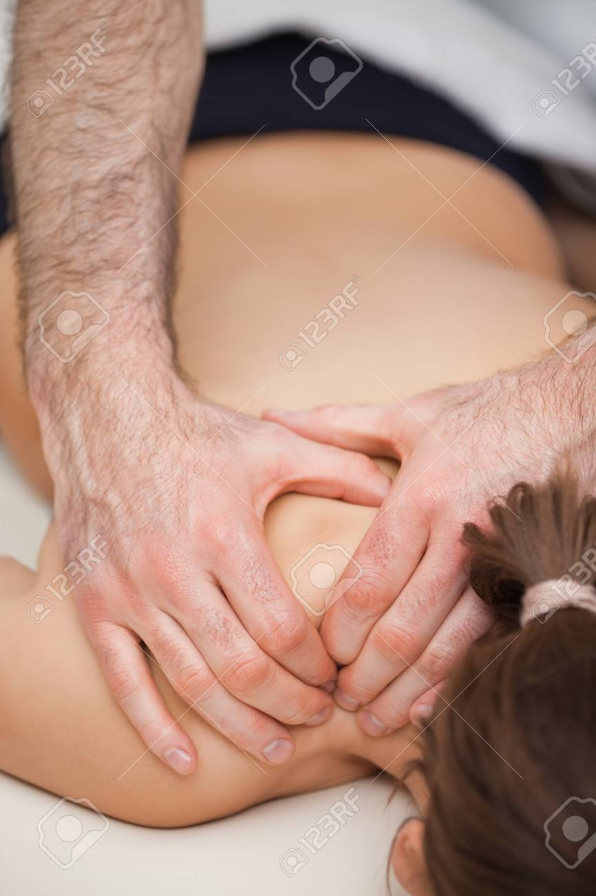 Osteopath pressing the shoulders of his patient while using his two hands indoors Stock Photo - 16206806