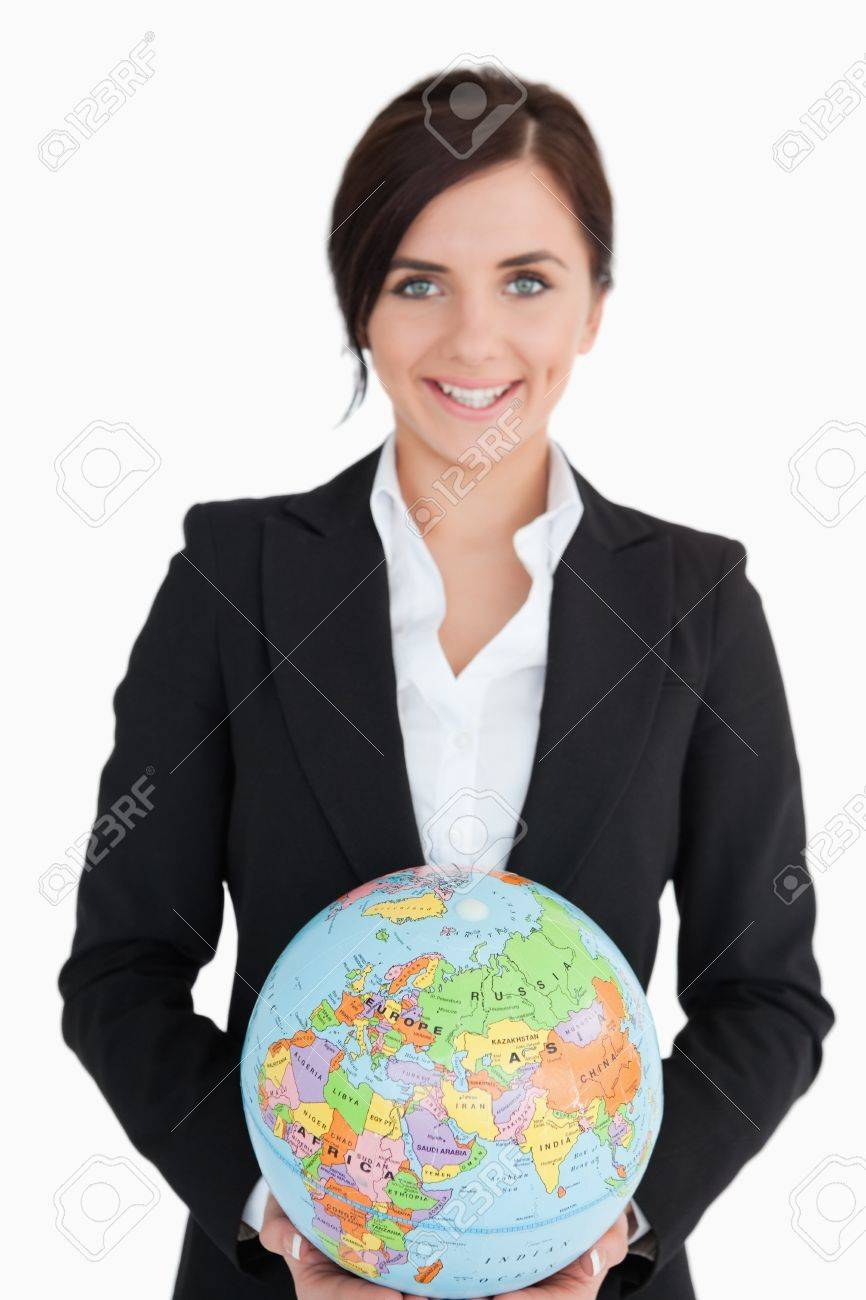 Smiling woman in suit holding an earth globe against white background Stock Photo - 16203296