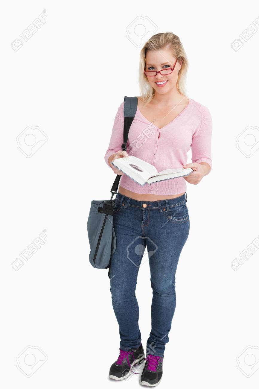 Blonde woman opening an interesting book against a white background Stock Photo - 16201022