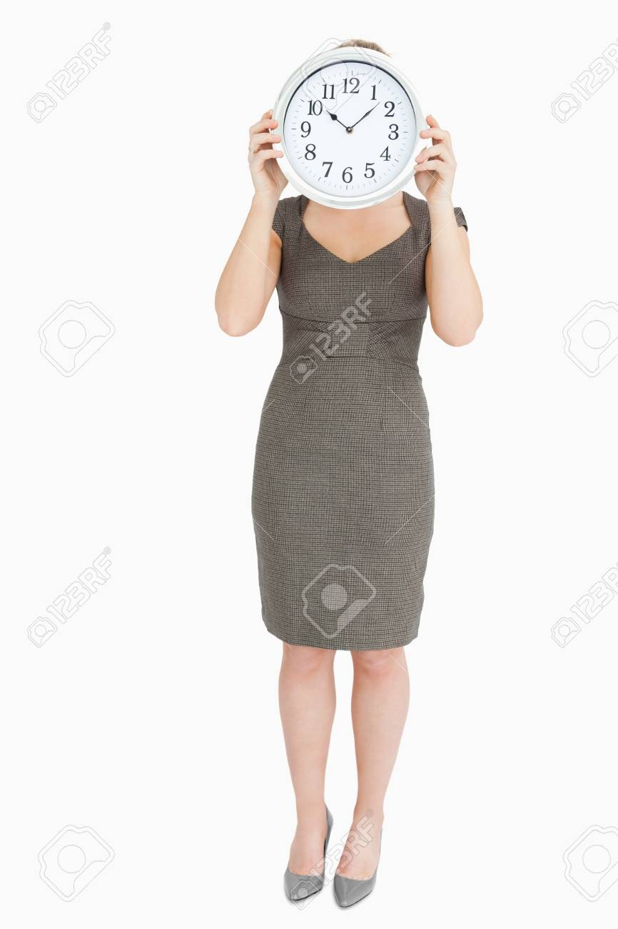 Woman holding a clock hiding her head against white background Stock Photo - 16201831
