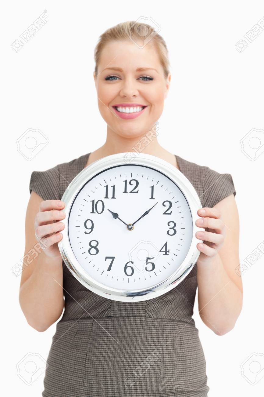 Woman holding a clock in her hands against white background Stock Photo - 16202765