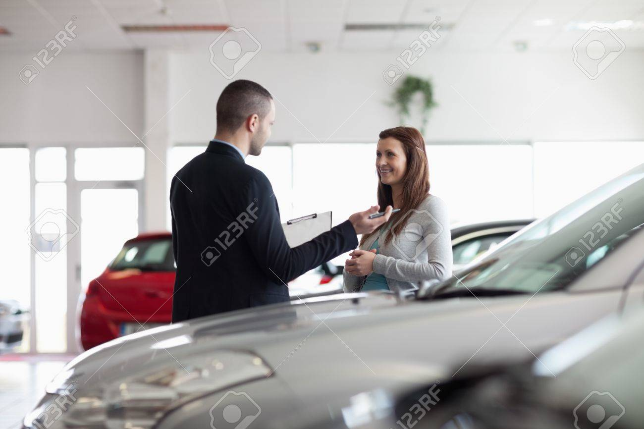 Dealer speaking with a client in a dealership Stock Photo - 16202920