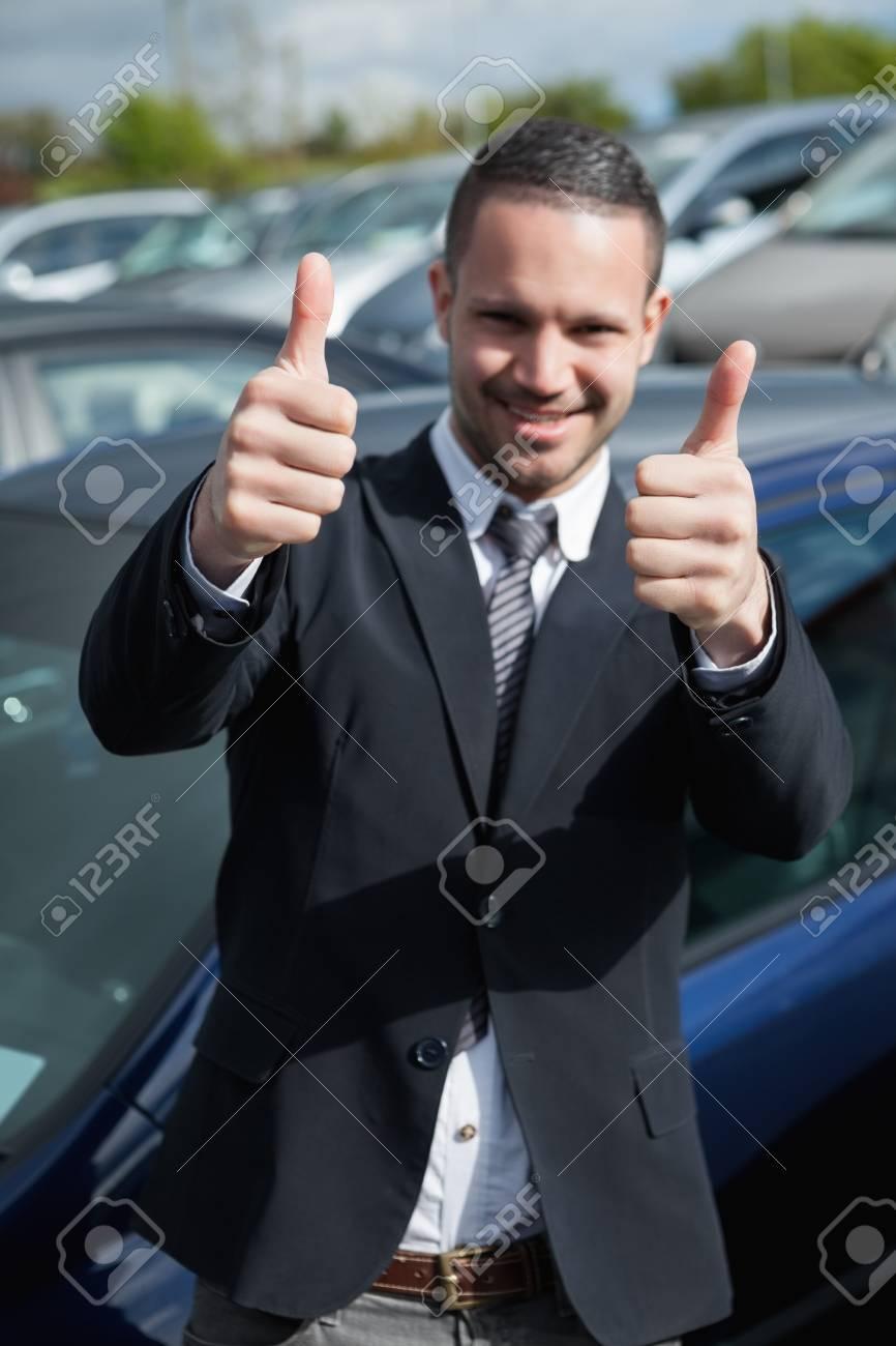 Happy man raising his thumbs outdoors Stock Photo - 16206908
