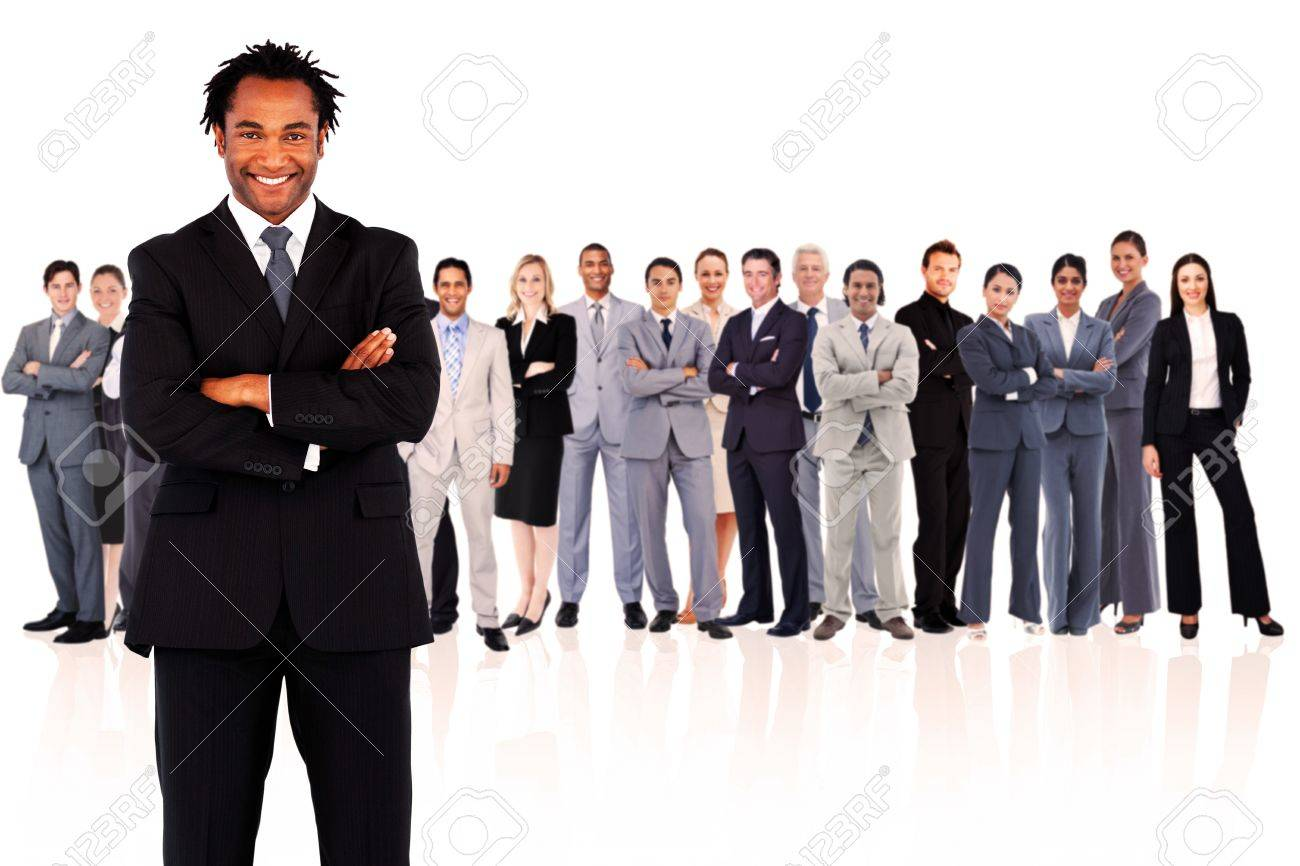 Businessman standing while smiling against a white background Stock Photo - 16201937