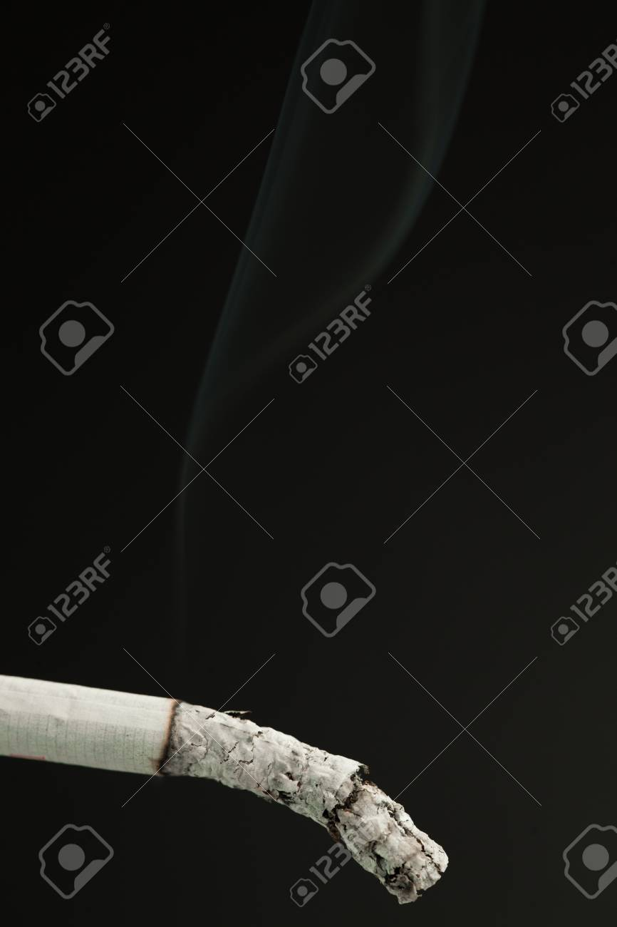 Ash of cigarette against a black background Stock Photo - 16206630