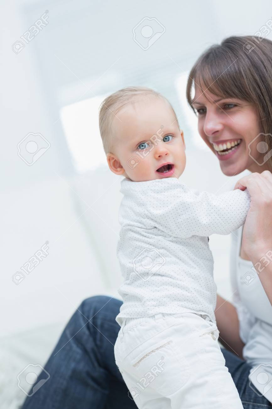 Mother with a baby in living room Stock Photo - 16203674