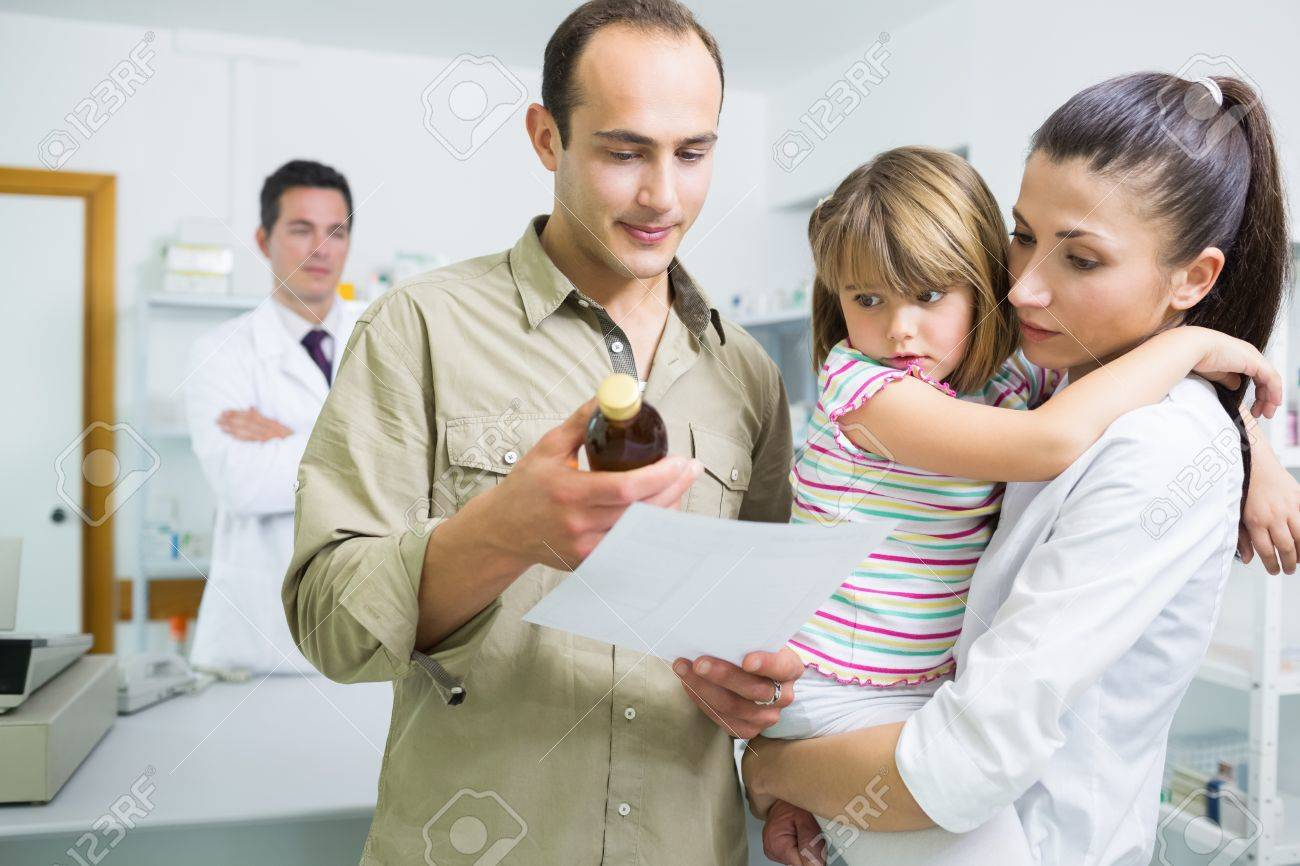 Family looking at medicine and a prescription in a pharmacy in a hospital Stock Photo - 18095449