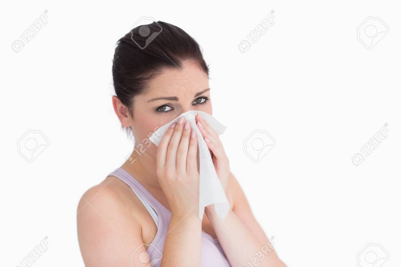 Sad woman blowing her nose against white background Stock Photo - 18123068