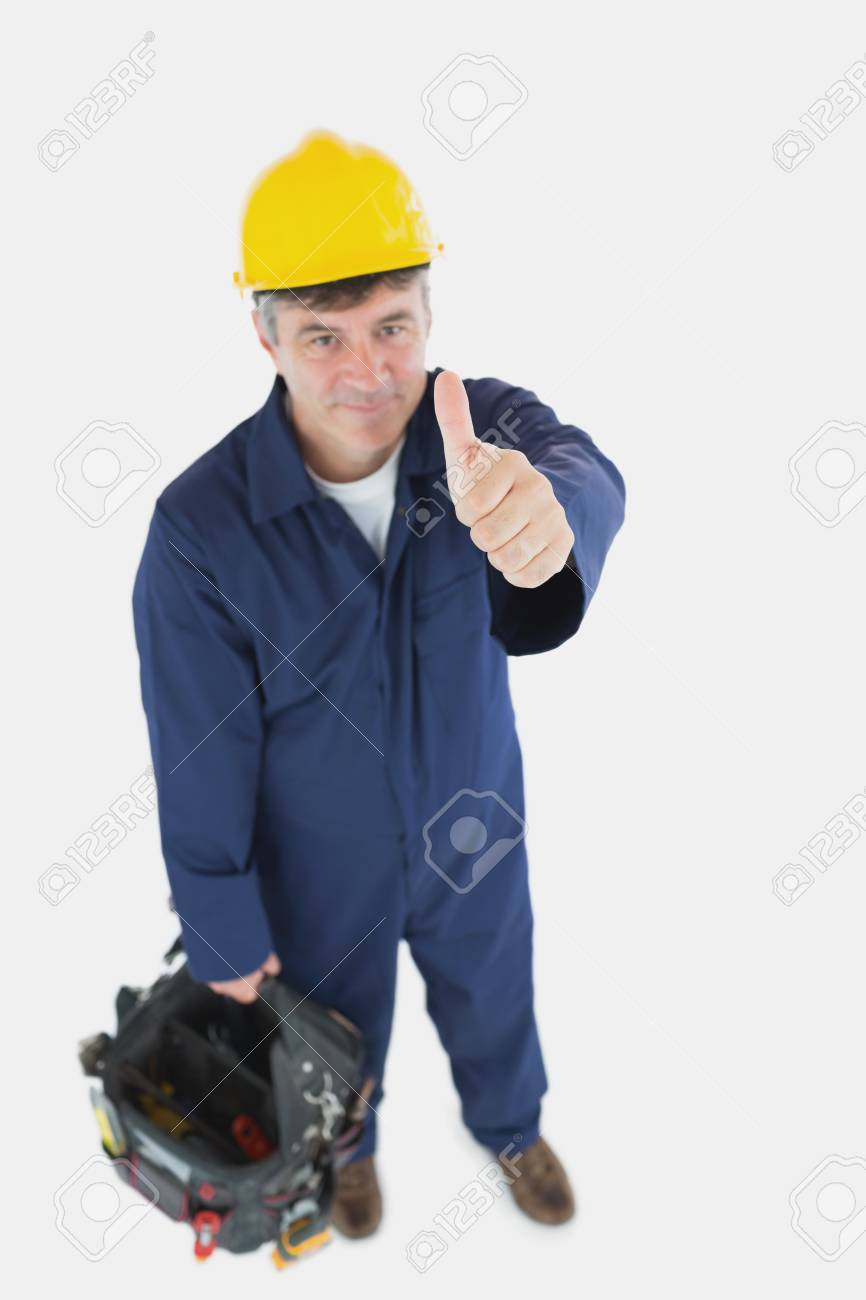 high angle view of mature man with tool bag showing thumbs up