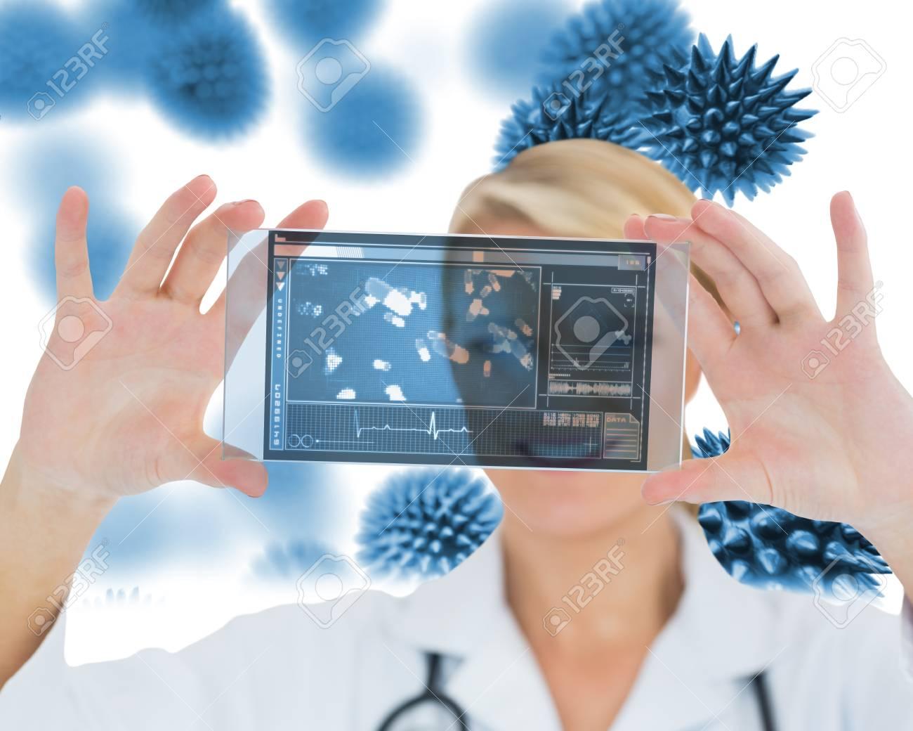 Joyful nurse holding a virtual screen in front of camera Stock Photo - 18106917