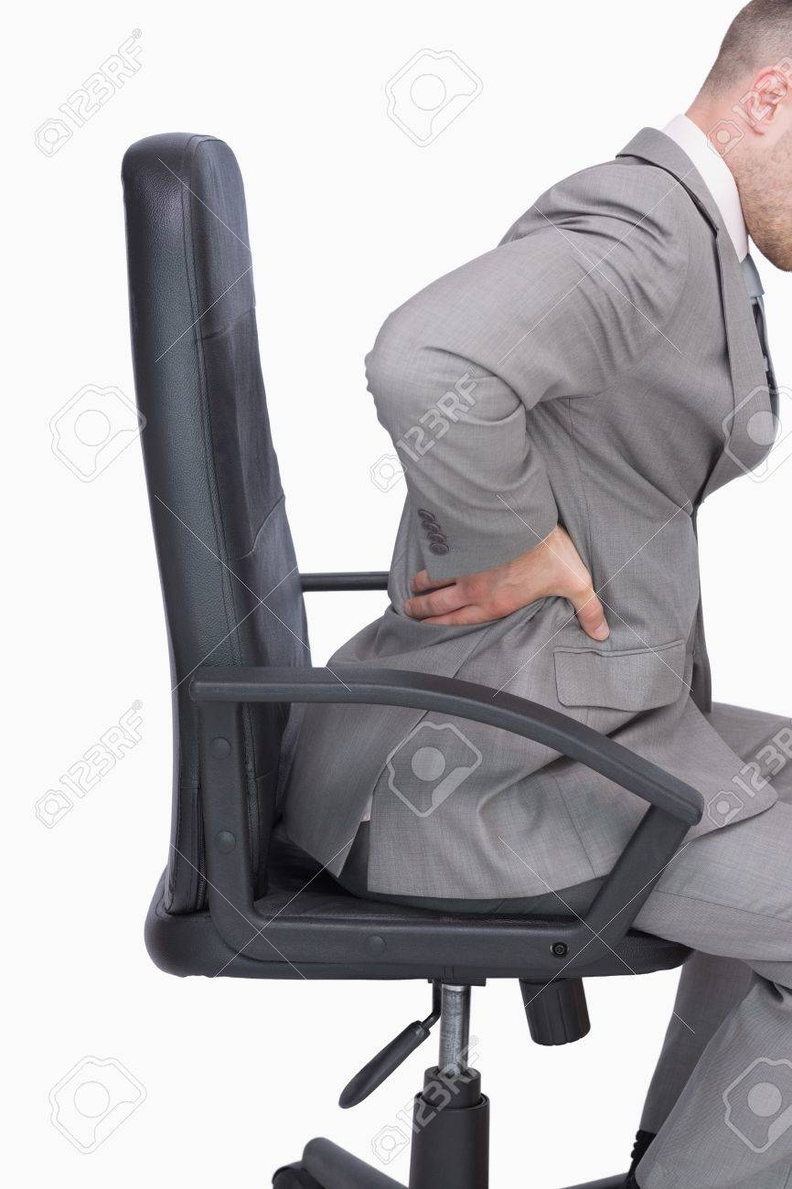 Man sitting in chair side - Side View Of Business Man With Backache Sitting In An Office Chair Over White Background Stock