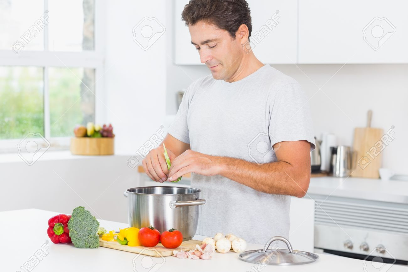 Happy Man Making Dinner In Kitchen Stock Photo   18109806