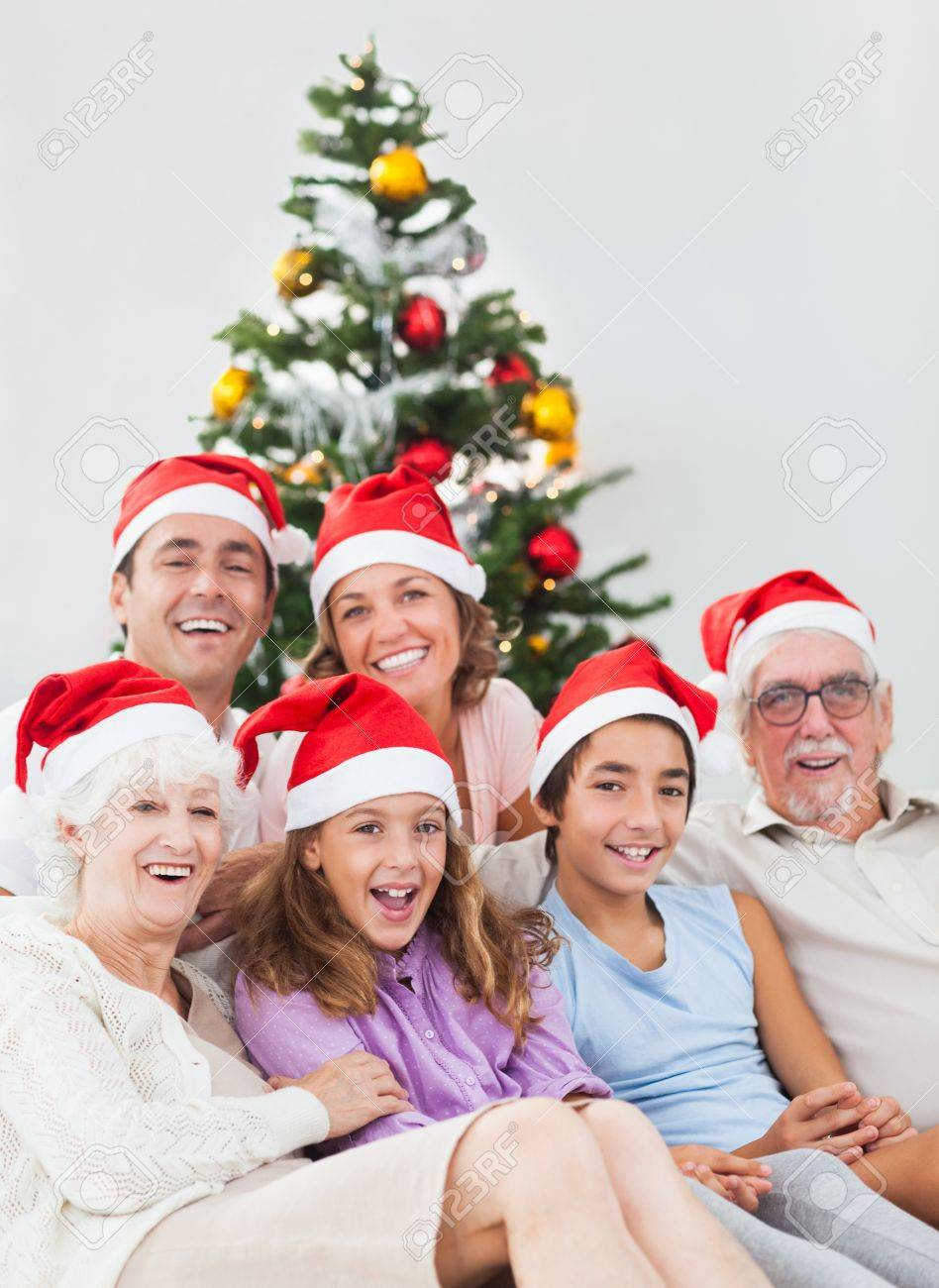 Happy family sitting on couch at christmas Stock Photo - 18118416