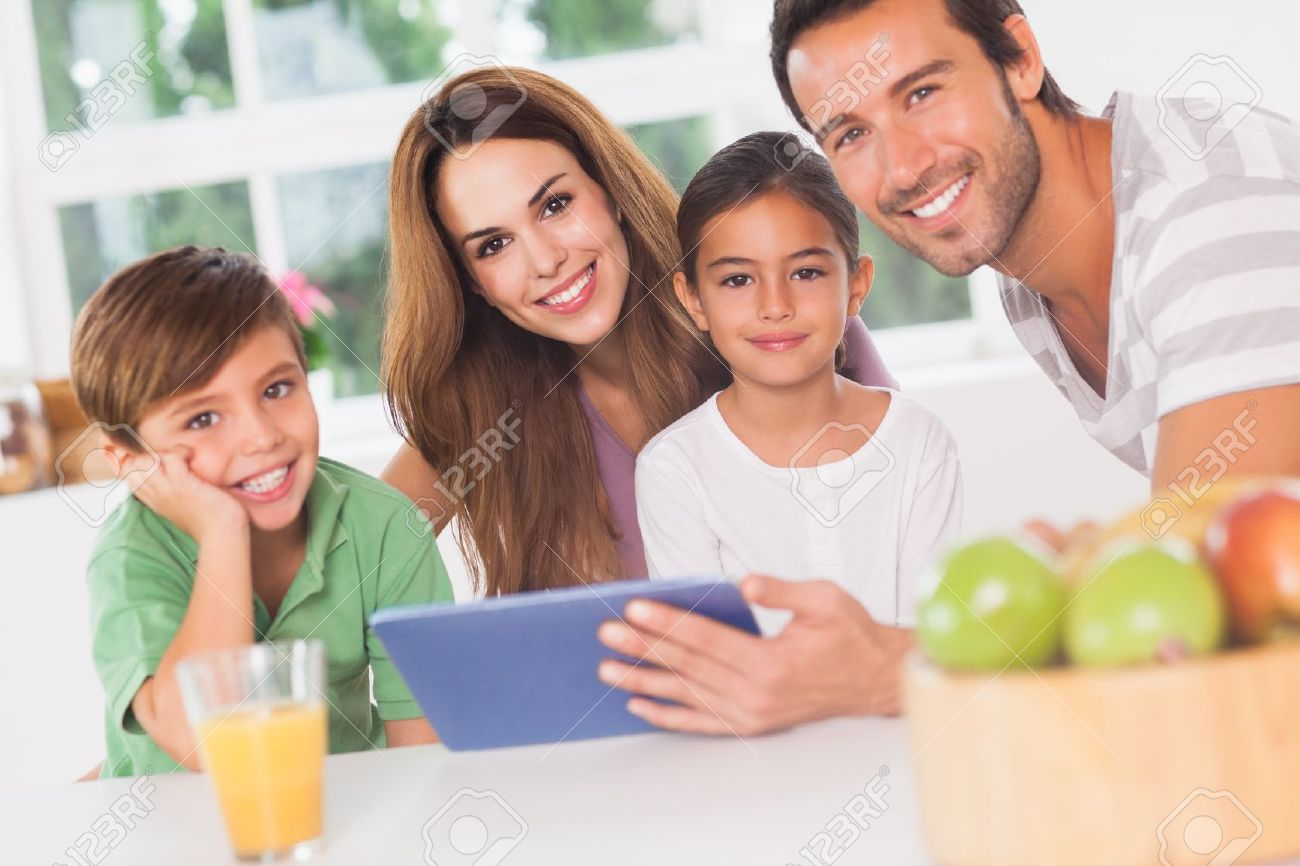 Happy family in kitchen - Happy Family Using A Tablet Pc In Kitchen Stock Photo Picture And Kitchen Design